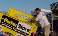 Cleaning the mud off the Donny Schatz sprint car